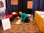 Sherie setting up the booth