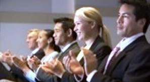 3475273-five-businesspeople-applauding-and-smiling-in-presentation-room