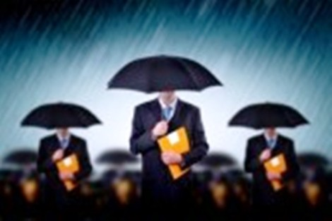 7558411-businessman-with-umbrellas-in-heavy-rain